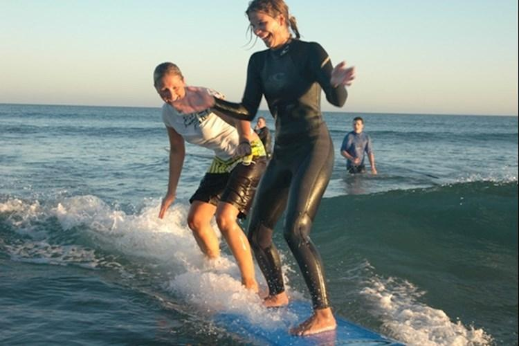 Surf Camp - Two Girls on Surfboard.jpg