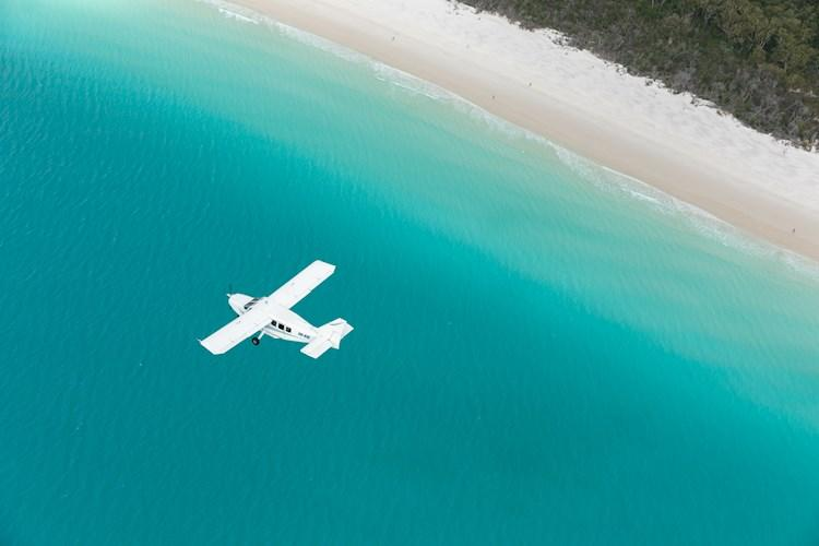 Flying over stunning Whitehaven Beach.jpg
