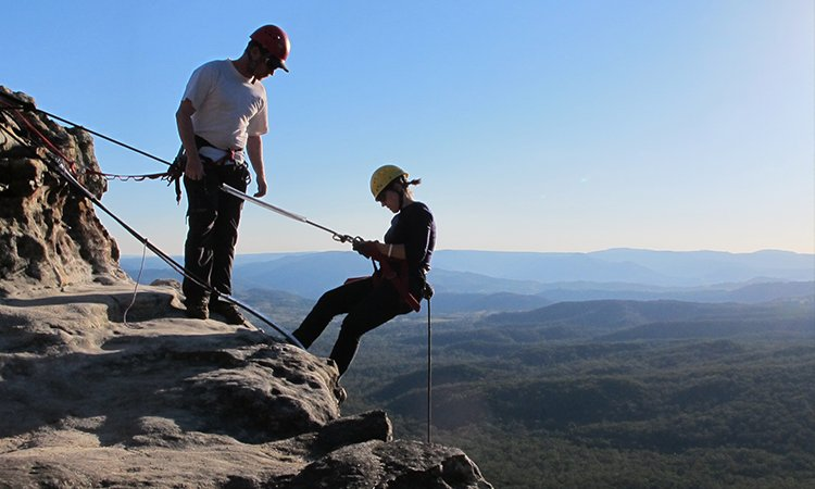 Abseiling on the Mountains Edge